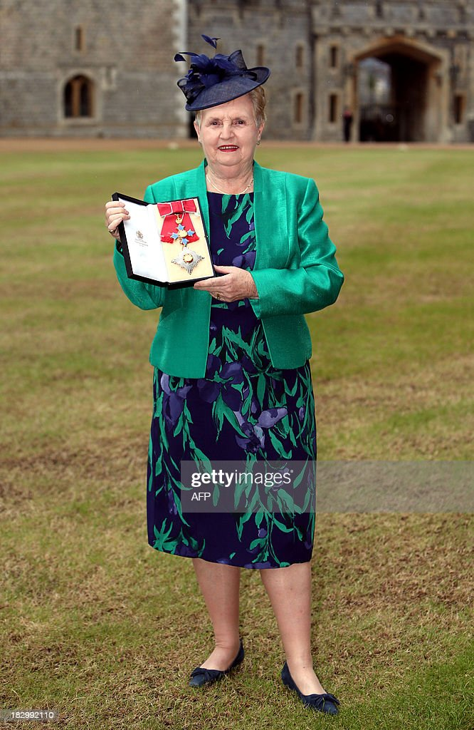 British Rowing Executive Chair Dame Diana Ellis poses with her Most Excellent Order for The British Empire (OBE) medal after receiving it for Services to Rowing at Windsor Castle in Berkshire, west of London, on October 3, 2013.