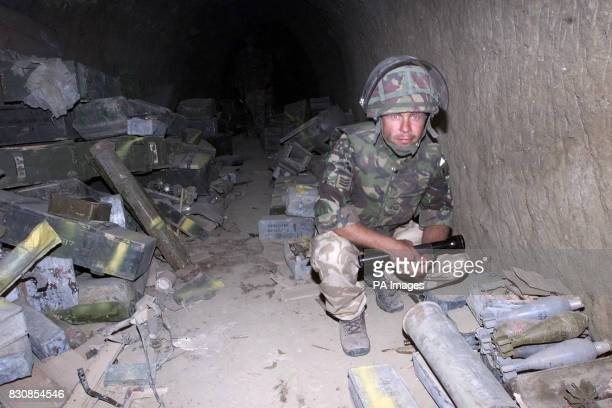 A British Royal Marine at one of the caves in Afghanistan where they found what their commander Brigadier Richard Lane described as a large weapons...