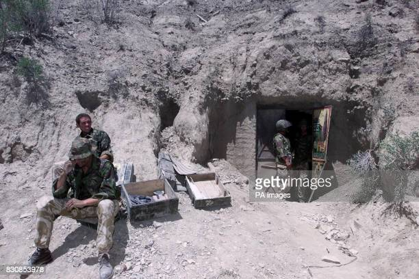 British Royal Marines at one of the caves in Afghanistan where they found what their commander Brigadier Richard Lane described as a large weapons...
