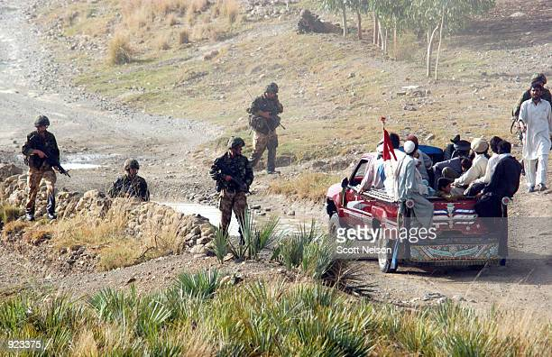 British Royal Marines of 45 Commando stop and search local traffic along a border road during an eagle vehicle check point operation as part of the...