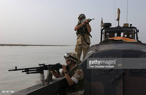 British Royal Marines of 539 Assault Squadron train their weapons on the marshes near Basra in case of ambush while on patrol during the first days...