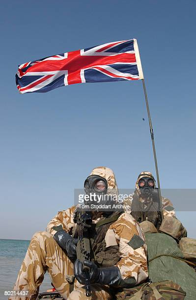British Royal Marines of 539 Assault Squadron training in chemical warfare gear in their Rigid Raider attack boats off Kuwait days before the...