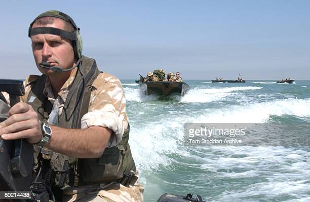 British Royal Marines of 539 Assault Squadron training in Rigid Raider attack boats off Kuwait days before the Americanled invasion of Iraq March...