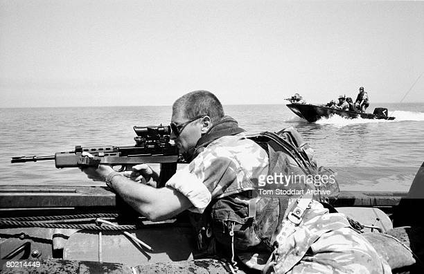 British Royal Marines of 539 Assault Squadron training in their Rigid Raider attack boats off Kuwait days before the Americanled invasion of Iraq...