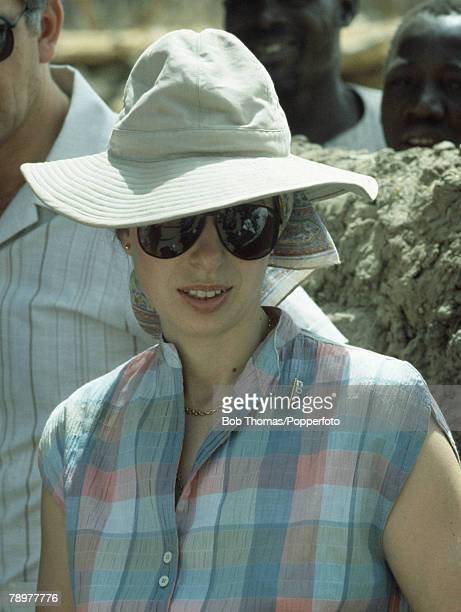 British Royalty Banjul The Gambia Africa February 1984 Princess Anne wearing a large safari style sun hat and sunglasses meeting local people during...