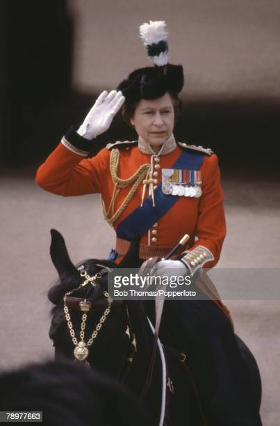 British Royalty Buckingham Palace London England June1981 Queen Elizabeth II on horse back taking the salute during the Trooping of the Colour...