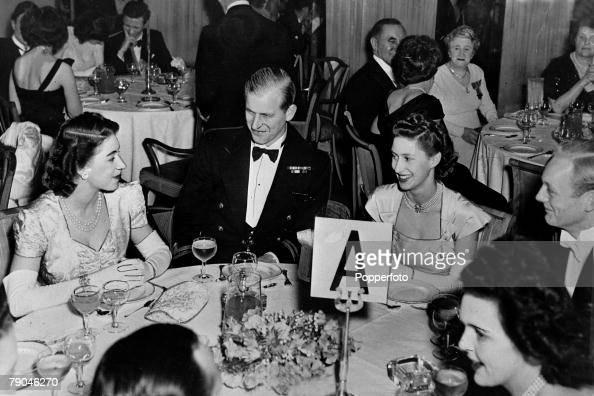 British Royalty. England. pic: 1950's. H.R.H.Princess Margaret (second right) pictured at the Dorchester Hotel, London with her sister Princess Elizabeth, (Queen Elizabeth II) the Duke of Edinburgh and Lord Montagu of Beaulieu, right. : News Photo