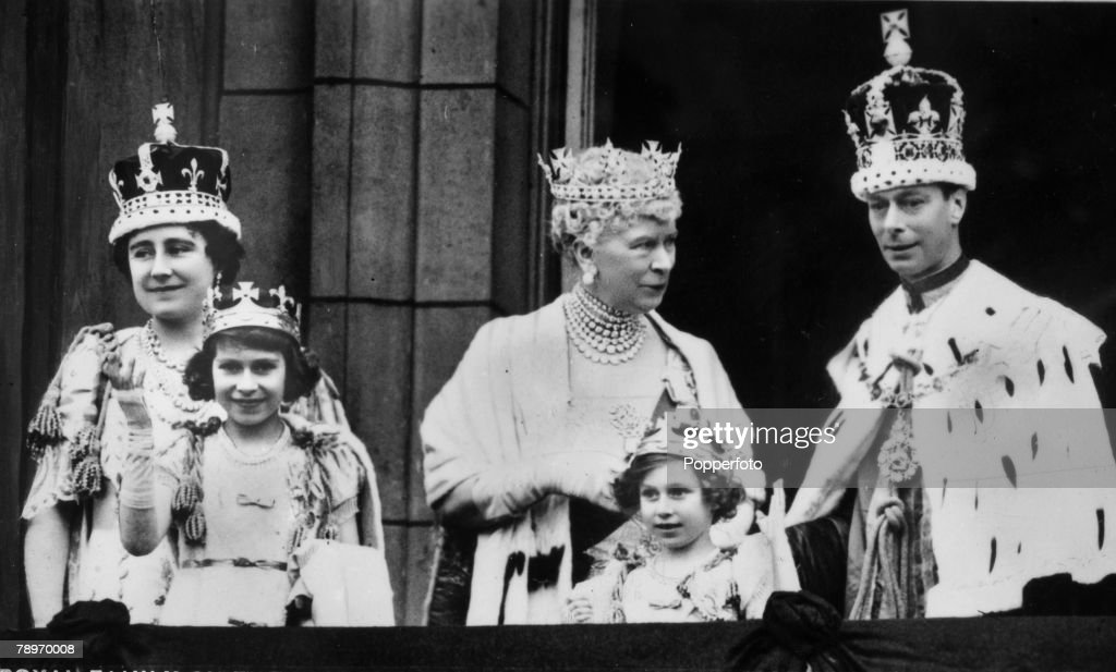 British Royalty, London, England, 12th May 1937, King George VI and Queen Elizabeth with Queen Mary and at the front their children Princess Elizabeth and Princess Margaret on the balcony at Buckingham Palace, after the Coronation ceremony at Westminster Abbey