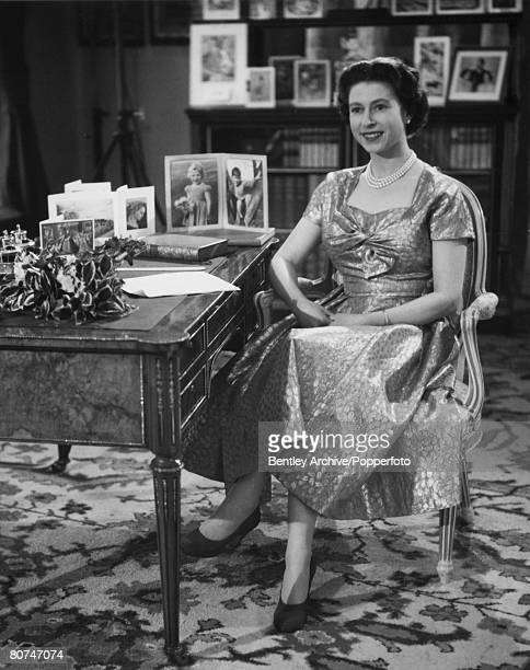 British Royalty London England 25th December 1957 Queen Elizabeth II sitting at her desk after giving her Christmas Day Television and Radio Broadcast