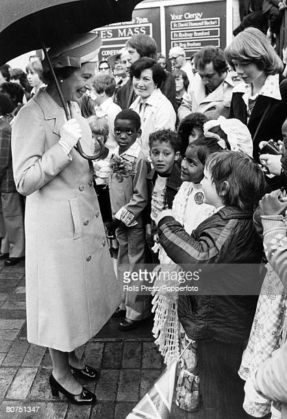 British Royalty London England 6th June 1977 HM Queen Elizabeth II is pictured talking to children at Deptford during a walkabout to commemorate her...