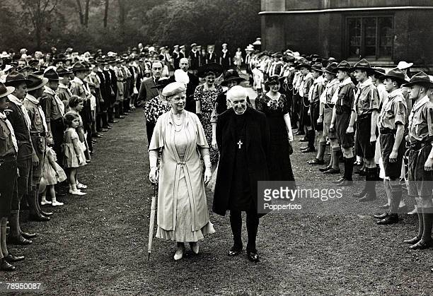 12th June 1937 HMQueen Mary and the Archbishop of Canterbury Dr Cosmo Gordon Lang walking through a Guard of Honour of Boy Scouts at a children's...