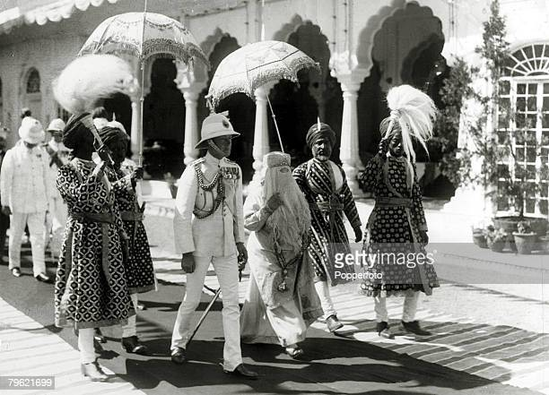 1922 HRHEdward Prince of Wales left pictured with the Begum of Bhopal walking to the Durbar Hall at the Sadar Manzil Palace while on his tour of...