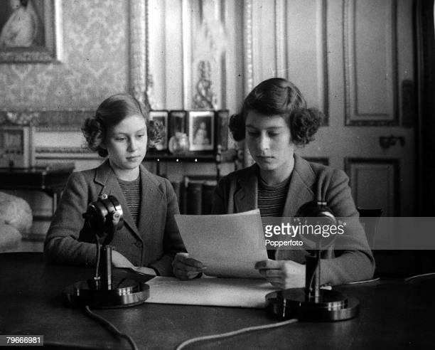 British Royalty Princess Elizabeth right broadcasting with her sister Princess Margaret alongside