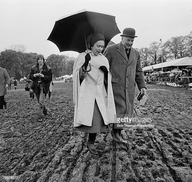 British Royalty Roayl Windsor Horse Show England Circa 1981 Queen Elizabeth II walks across a muddy field with an unidentified official