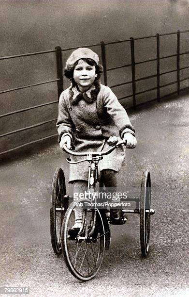 British Royalty The young Princess Elizabeth is pictured riding on her tricycle Circa 1930