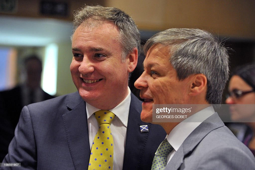 British Rurals Affairs Minister Richard Lochhead (L) and EU agriculture and rural development commissioner Dacian Ciolos talk on December 19, 2012 before an Agriculture and Fisheries Council meeting at EU headquarters in Brussels. AFP PHOTO / GEORGES GOBET