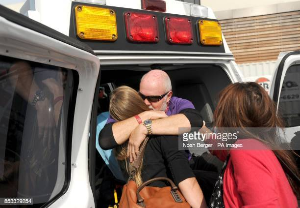 British sailor Andrew Taylor gets a hug as the Derry~Londonderry~Doire arrives in San Francisco on Friday April 11 during the Clipper Round the World...