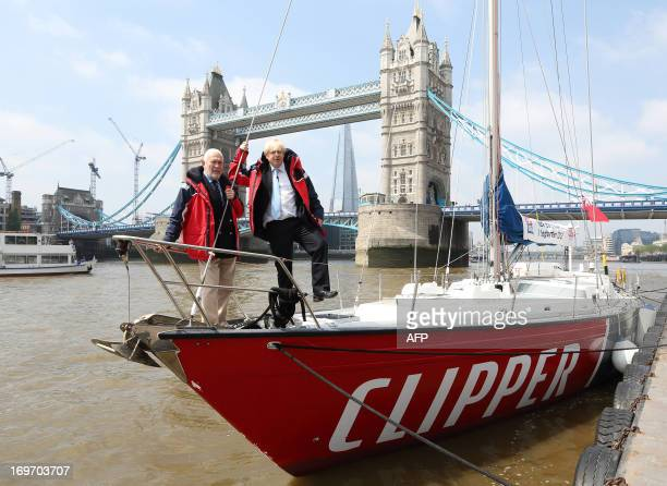 British sailor Robin KnoxJohnston and mayor of London Boris Johnson pose for photographers on board a yacht on the river Thames beside Tower Bridge...