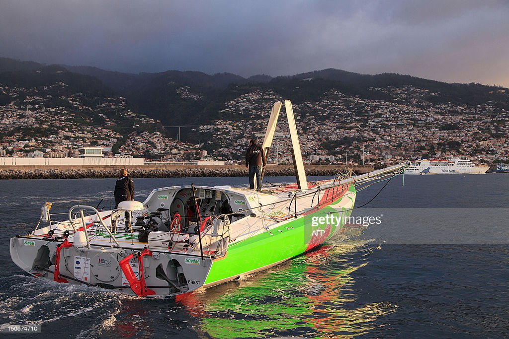 British sailor Samantha Davies (L) arrives on November 17, 2012 in Funchal, on the island of Madeira, Portugal, after her partner Romain Attanasio joined her on board. Davies, who was eliminated from the solo, round-the-world Vendee Globe after the dismasting of her yacht, limped into Madeira on November 17. The 38-year-old, the only woman in the world's most gruelling yacht race, saw her boat dismasted on Thursday evening in strong winds about 130 nautical miles northeast of Madeira, the Portuguese island in the Atlantic Ocean.
