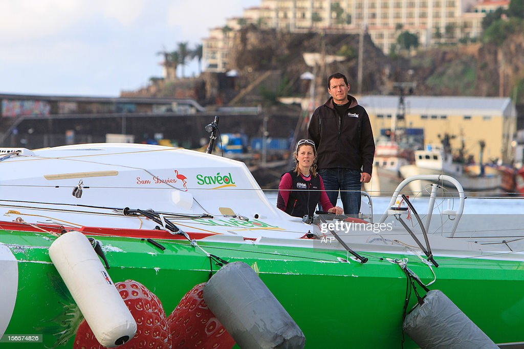 British sailor Samantha Davies (L) arrives on November 17, 2012 in Funchal, on the island of Madeira, Portugal, with her partner Romain Attanasio who joined her on board. Davies, who was eliminated from the solo, round-the-world Vendee Globe after the dismasting of her yacht, limped into Madeira on November 17. The 38-year-old, the only woman in the world's most gruelling yacht race, saw her boat dismasted on Thursday evening in strong winds about 130 nautical miles northeast of Madeira, the Portuguese island in the Atlantic Ocean. AFP PHOTO / GREGORIO CUNHA