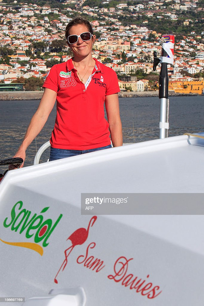 British sailor Samantha Davies poses aboard her yacht 'Saveol' in Funchal, on the island of Madeira, Portugal, on November 18, 2012. The 38-year-old, the only woman in the world's most gruelling yacht race, saw her boat dismasted on November 15 in strong winds about 130 nautical miles northeast of Madeira, the Portuguese island in the Atlantic Ocean. AFP PHOTO / GREGORIO CUNHA
