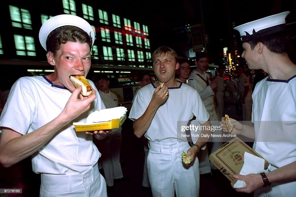 British sailors, here for Fleet Week, seem to have mixed feelings about American hot dogs at Nathan's in Times Square.,