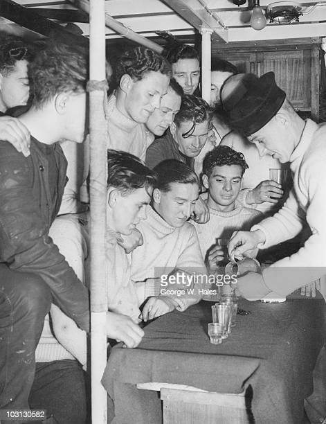 British sailors 'splice the mainbrace' on a Royal Naval motor launch during convoy duty in the English Channel World War II 29th March 1943 The term...
