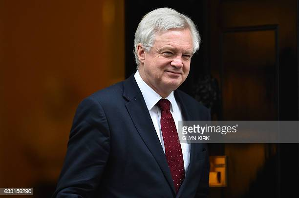 British Secretary of State for Exiting the European Union David Davis leaves the weekly meeting of the cabinet at 10 Downing Street in central London...