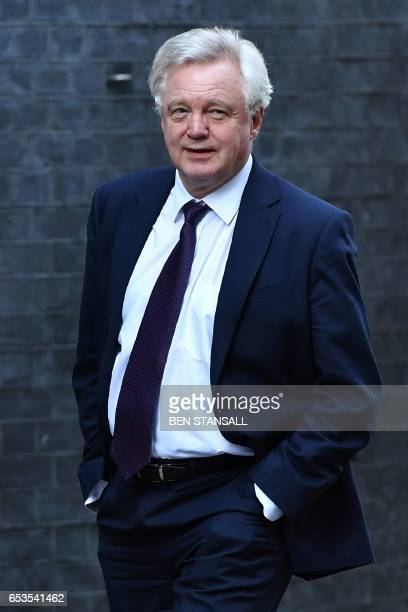 British Secretary of State for Exiting the European Union David Davis arrives in Downing Street in London on March 15 2017 Britain's Prime Minister...