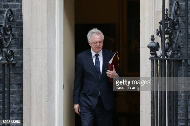 British Secretary of State for Exiting the European Union David Davis leaves after attending the weekly cabinet meeting at 10 Downing Street in...