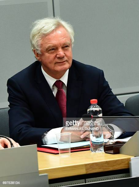 British Secretary of State for Exiting the European Union David Davis and his delegation attend a meeting with European Union's French chief Brexit...