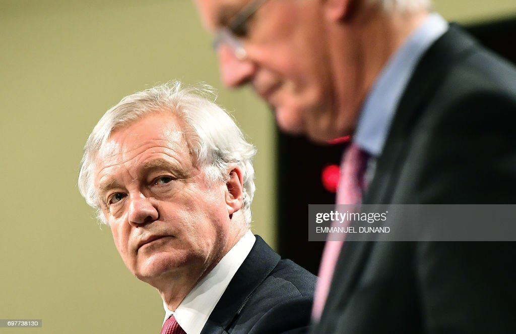 British Secretary of State for Exiting the European Union (Brexit Minister) David Davis (L) and European Commission member in charge of Brexit negotiations with Britain, Michel Barnier address a press conference at the end of the first day of Brexit negotiations at the European Commission in Brussels on June 19, 2017. Britain and the European Union started Brexit negotiations in Brussels on June 19, 2017. /