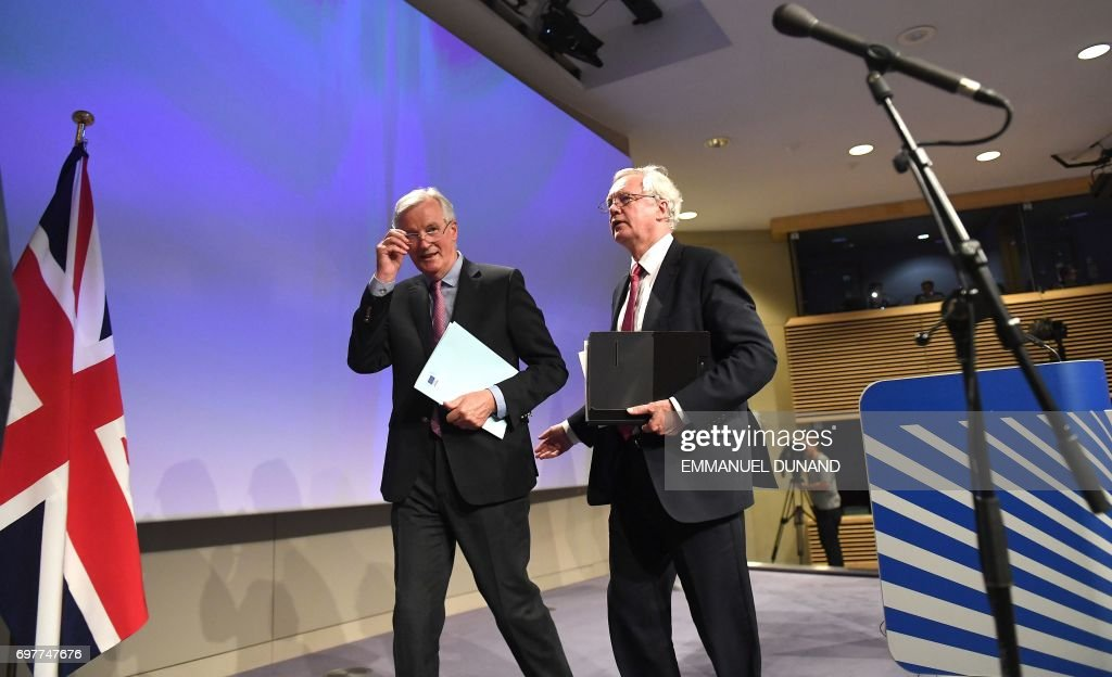 British Secretary of State for Exiting the European Union (Brexit Minister) David Davis (R) and European Commission member in charge of Brexit negotiations with Britain, Michel Barnier leave after addressing a press conference at the end of the first day of Brexit negotiations at the European Commission in Brussels on June 19, 2017. Britain and the European Union started Brexit negotiations in Brussels on June 19, 2017. /