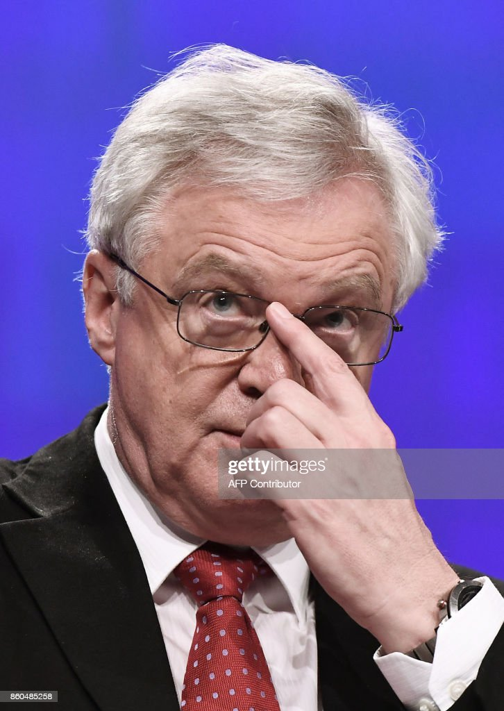 British Secretary of State for Exiting the European Union (Brexit Minister) David Davis addresses media representatives at the European Union Commission in Brussels on October 12, 2017. Davis said he still hoped that the 27 other EU leaders could decide to shift to the next phase when they meet for a summit in Brussels next week. /