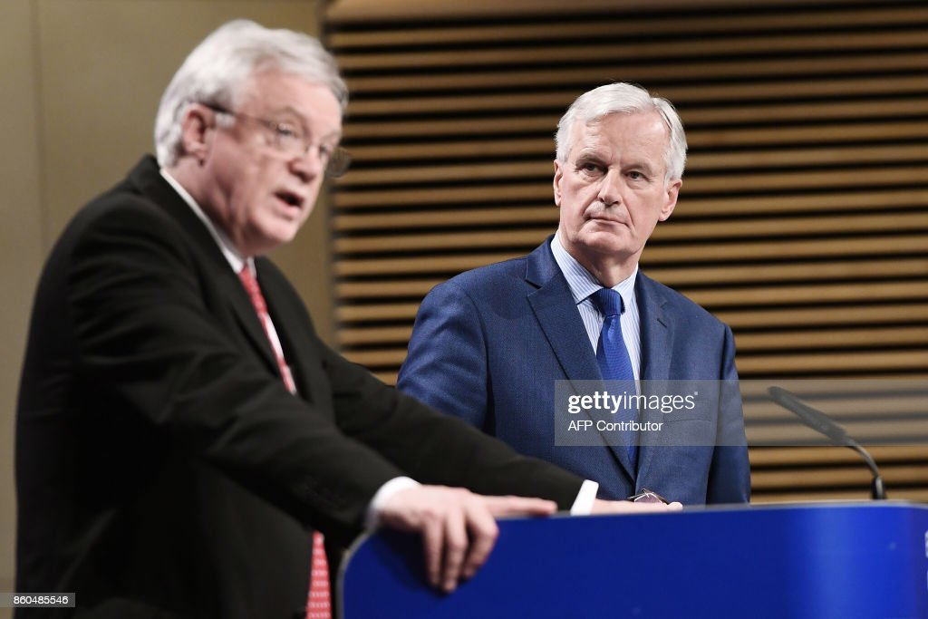British Secretary of State for Exiting the European Union (Brexit Minister) David Davis (L) and European Union Chief Negotiator in charge of Brexit negotiations with Britain Michel Barnier (R) address media representatives at the European Union Commission in Brussels on October 12, 2017. Wrapping up a fifth round of talks with David Davis, Britain's Brexit minister, Barnier said there was not enough progress to recommend that negotiations should move from divorce issues to trade. /