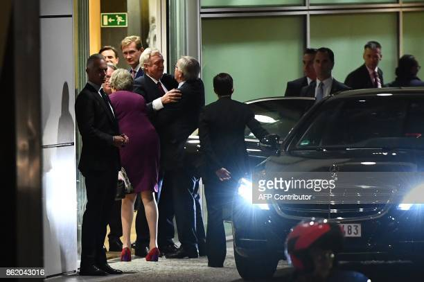 British Secretary of State for Exiting the European Union David Davis hugs European Commission President JeanClaude Juncker next to British Prime...