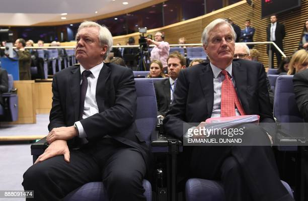 British Secretary of State for Exiting the European Union David Davis and EU's chief Brexit negotiator Michel Barnier attend a press conference by...