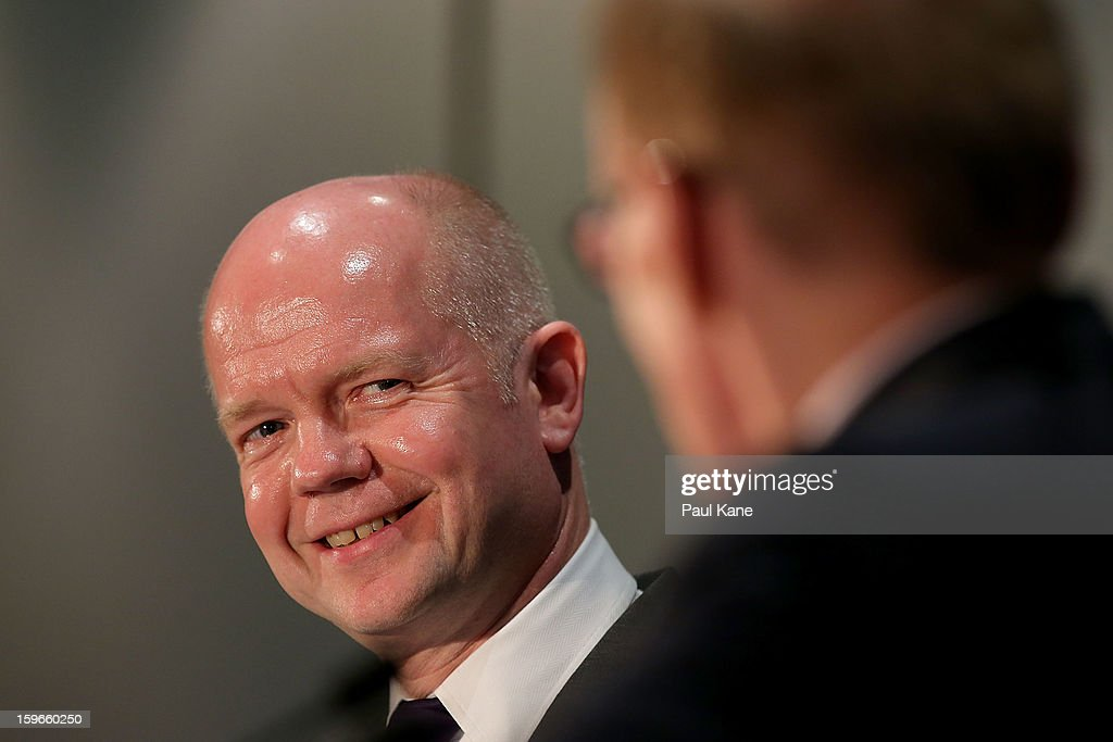 British secretary of state for foreign and commonwealth affairs <a gi-track='captionPersonalityLinkClicked' href=/galleries/search?phrase=William+Hague&family=editorial&specificpeople=206295 ng-click='$event.stopPropagation()'>William Hague</a> looks on as Australian foreign affairs minister <a gi-track='captionPersonalityLinkClicked' href=/galleries/search?phrase=Bob+Carr&family=editorial&specificpeople=209391 ng-click='$event.stopPropagation()'>Bob Carr</a> addresses the media during the annual Australia-United Kingdom Ministerial meetings on January 18, 2013 in Perth, Australia. The ministers meet to discuss defence and foreign affairs during the annual one-day summit.