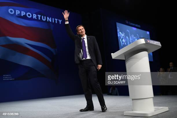 British Secretary of State for Health Jeremy Hunt waves after addressing delegates on the third day of the annual Conservative party conference in...