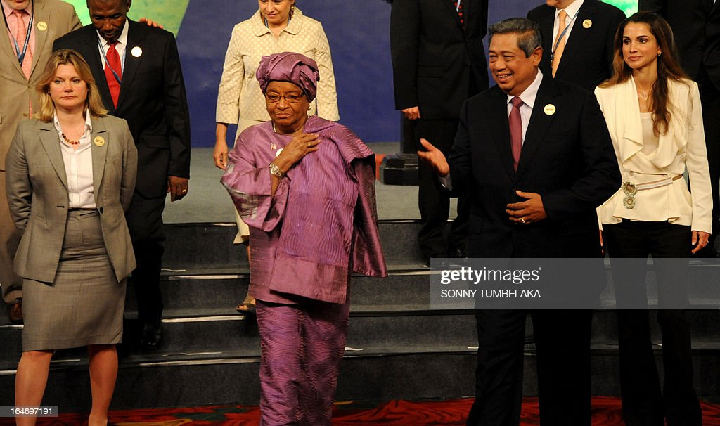, British Secretary of State for International Development Justine Greening, Liberian President Ellen Johnson Sirleaf, Indonesian President Susilo Bambang Yudhoyono and Queen Rania of Jordan pose for a group photo during a conference in Nusa Dua on Bali island on March 27, 2013. The 4th Meeting and Related Meetings of High-level Panel of Eminent Persons on the Post-2015 Development Agenda will be held from March 25 - 27 on the Indonesia resort island of Bali.