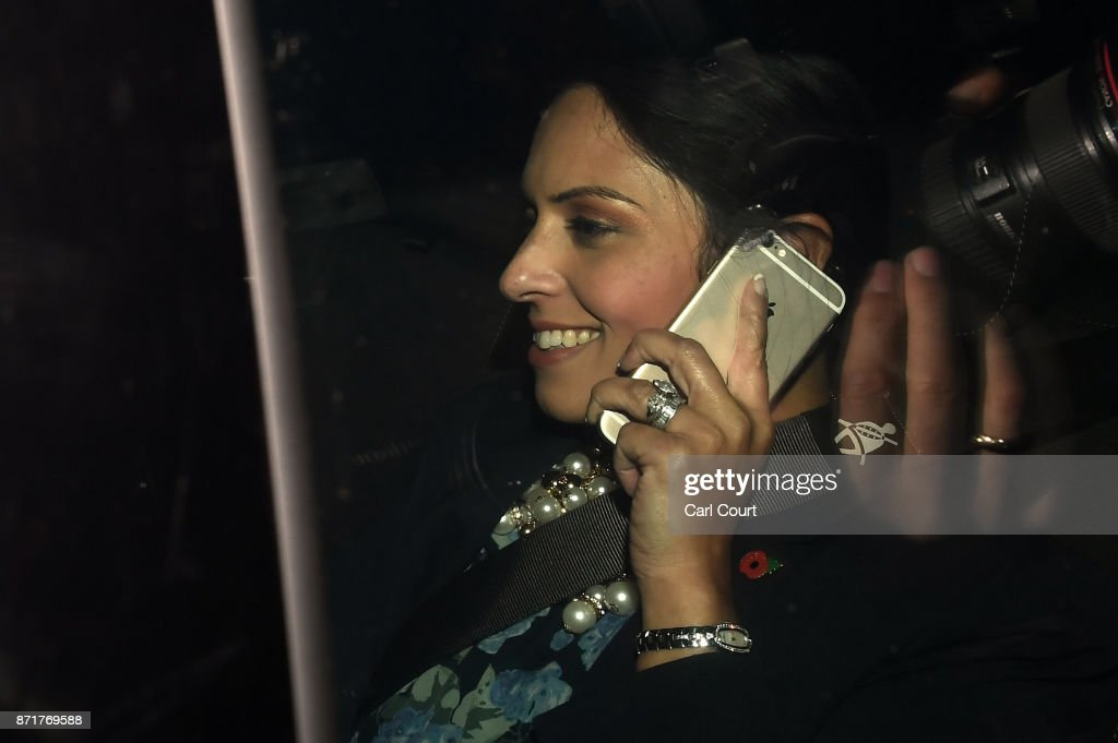 British Secretary of State for International Development Priti Patel talks on a mobile phone in a car as she arrives to Downing Street on November 8, 2017 in London, England. Ms Patel has been summoned back to the U.K from an official trip to Uganda as more details of her unofficial meetings with Israeli officials emerge.