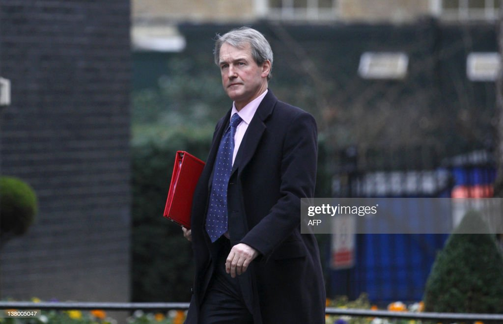 British Secretary of State for Northern Ireland Owen Paterson arrives at number 10 Downing Street to attend the weekly meeting of the Cabinet in...
