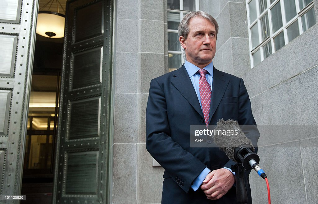 British Secretary of State for the Department of the Environment Food and Rural Affairs Owen Paterson addresses the media outside his department on...
