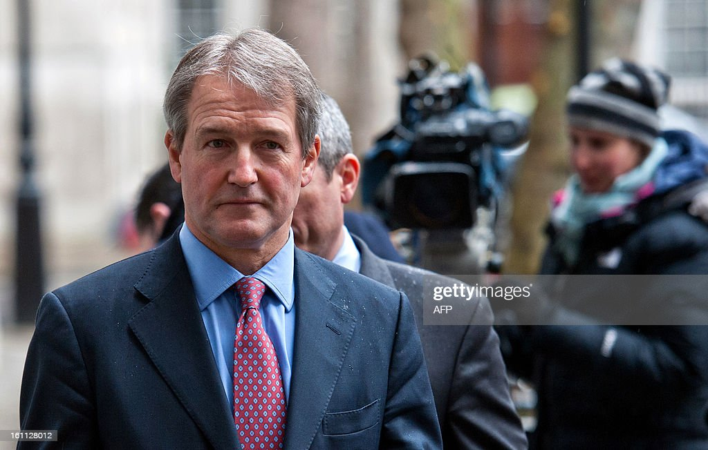 British Secretary of State for the Department of the Environment Food and Rural Affairs Owen Paterson addresses the media outside his department in...