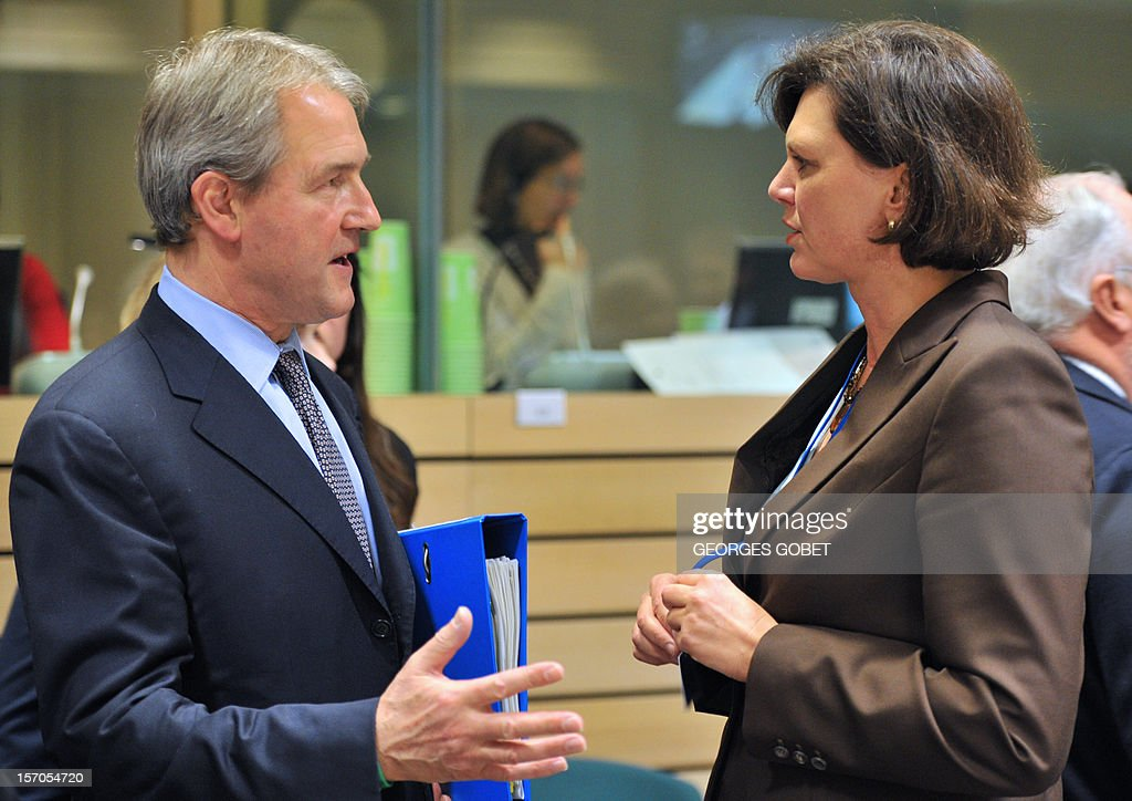 British secretary of State for the Environment Food and Rural Affairs Owen Paterson and German Agriculture Minister Ilse Aigner (R) talk prior to an Agriculture and Fisheries Council on November 28, 2012 at the EU Headquarters in Brussels.