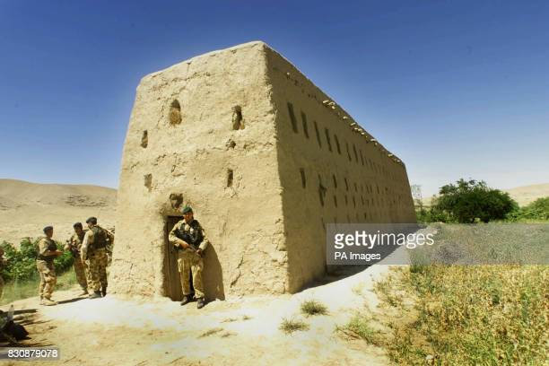 British service personnel stand guard over the mudbrick barn in Atalay village 50 miles northwest of Kandahar in southern Afghanistan where Royal...