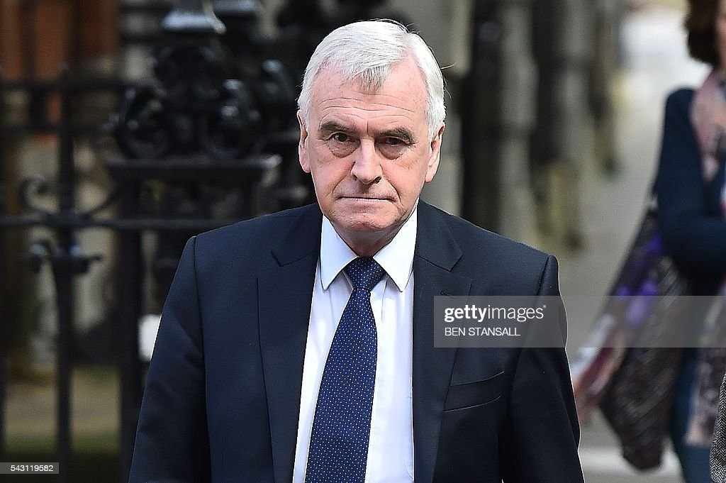 British Shadow Chancellor of the Exchequer John McDonnell arrives at Millbank television and radio studios in central London on June 26, 2016. The future of opposition Labour leader Jeremy Corbyn looked shaky on Sunday after two members of his top team quit and others seemed set to follow over his handling of Britain's EU referendum. Corbyn sacked his foreign affairs spokesman, Hilary Benn, late Saturday after Benn said he no longer had confidence in his leadership, while health spokeswoman Heidi Alexander announced her resignation on Twitter Sunday. / AFP / BEN