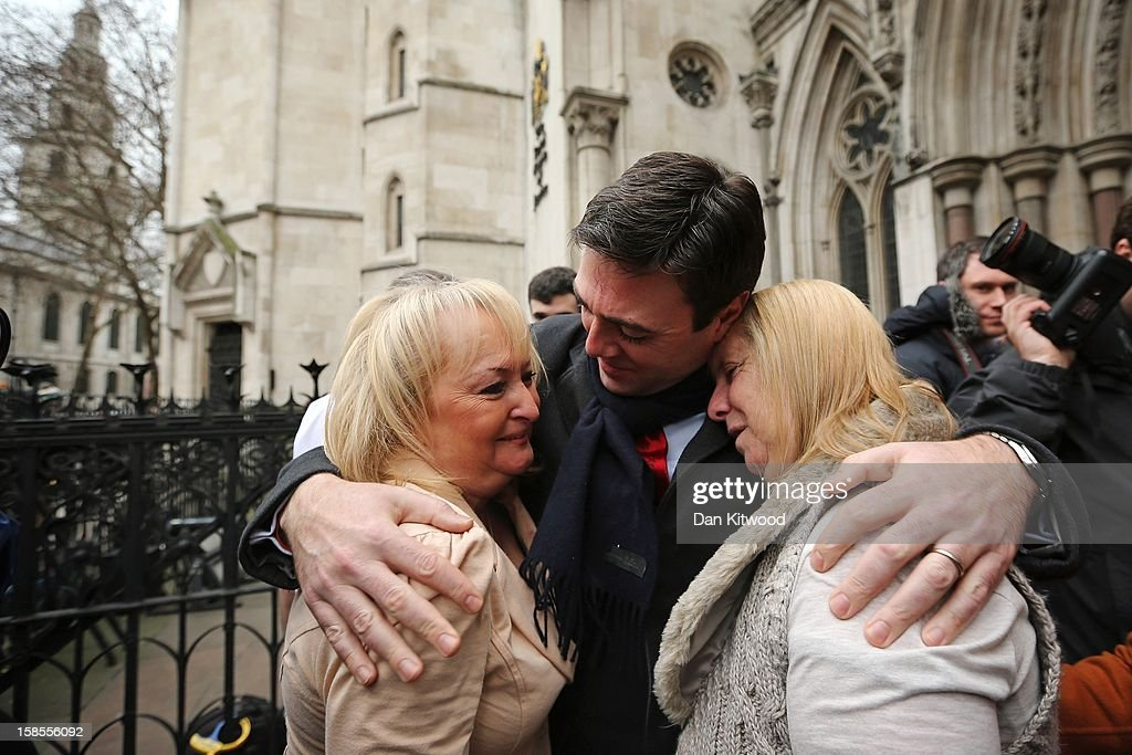British Shadow Health Secretary and Labour Party member Andy Burnham (C) embraces Jenni Hicks (L), who lost her two teenage daughters Sarah and Victoria, and Margaret Aspinall (R), who lost her son James, in the Hillsborough Disaster, outside the High Court on December 19, 2012 in London, England. An application presented by the attorney general, Dominic Grieve to Lord Chief Justice, Lord Judge has resulted in the quashing of the original accidental death verdict and an order for fresh inquests. The Hillsborough Disaster occurred during the FA Cup semi-final tie between Liverpool and Nottingham Forest football clubs in April 1989 at the Hillsborough Stadium in Sheffield, which resulted in the deaths of 96 football fans.