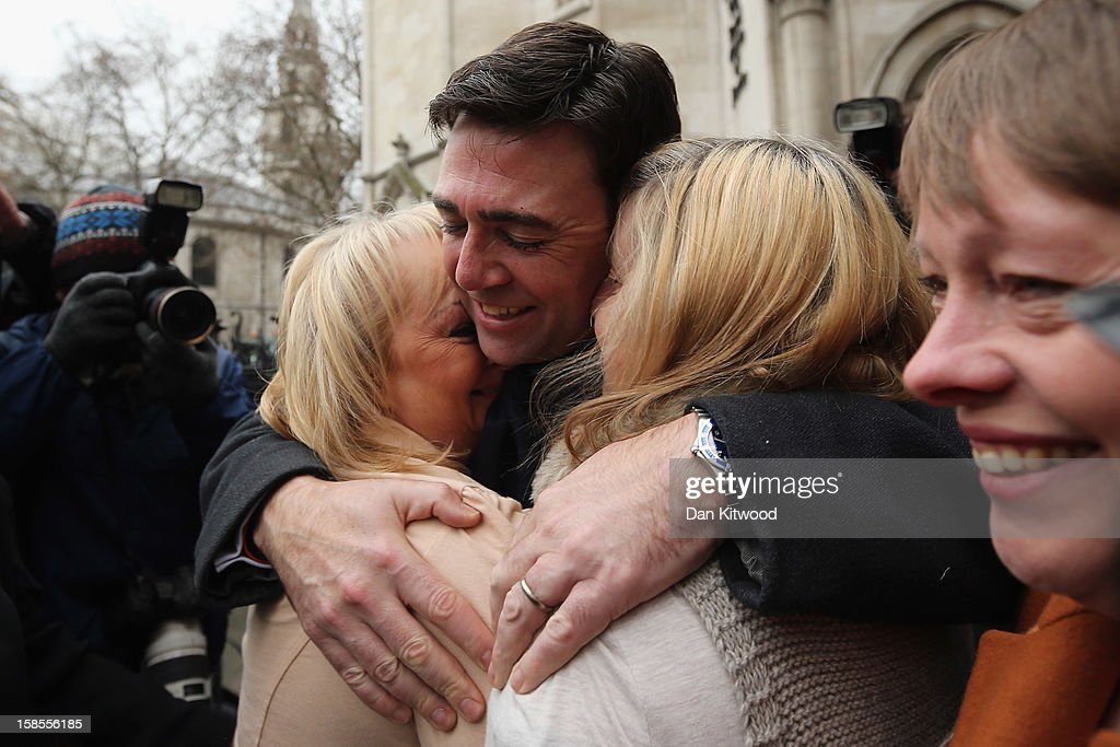 British Shadow Health Secretary and Labour Party member Andy Burnham (C) embraces Jenni Hicks (L), who lost her two teenage daughters Sarah and Victoria, and Margaret Aspinall (R) who lost her son James in the Hillsborough Disaster, outside the High Court on December 19, 2012 in London, England. An application presented by the attorney general, Dominic Grieve to Lord Chief Justice, Lord Judge has resulted in the quashing of the original accidental death verdict and an order for fresh inquests. The Hillsborough Disaster occurred during the FA Cup semi-final tie between Liverpool and Nottingham Forest football clubs in April 1989 at the Hillsborough Stadium in Sheffield, which resulted in the deaths of 96 football fans.
