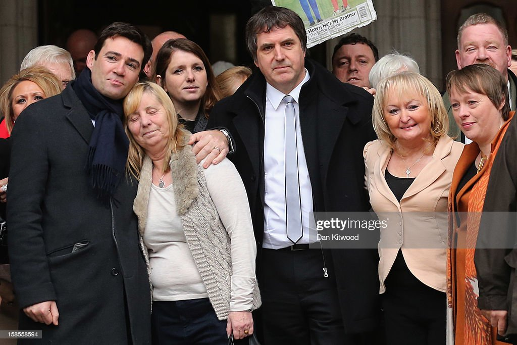 British Shadow Health Secretary and Labour Party member <a gi-track='captionPersonalityLinkClicked' href=/galleries/search?phrase=Andy+Burnham&family=editorial&specificpeople=469823 ng-click='$event.stopPropagation()'>Andy Burnham</a> (L) stands with <a gi-track='captionPersonalityLinkClicked' href=/galleries/search?phrase=Margaret+Aspinall&family=editorial&specificpeople=6899634 ng-click='$event.stopPropagation()'>Margaret Aspinall</a>, MP Steve Rotheram, Jenni Hicks and other members of families who lost relatives in the Hillsborough disaster outside the High Court on December 19, 2012 in London, England. An application presented by the attorney general, Dominic Grieve to Lord Chief Justice, Lord Judge has resulted in the quashing of the original accidental death verdict and an order for fresh inquests. The Hillsborough Disaster occurred during the FA Cup semi-final tie between Liverpool and Nottingham Forest football clubs in April 1989 at the Hillsborough Stadium in Sheffield, which resulted in the deaths of 96 football fans.
